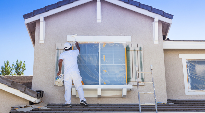 Busy House Painter Painting the Trim And Shutters of A Home in Los Angeles